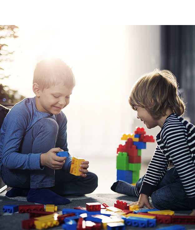 Two boys playing with blocks.