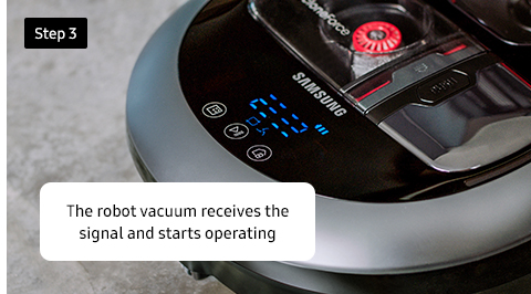 The robot vacuum receives the signal and starts operating