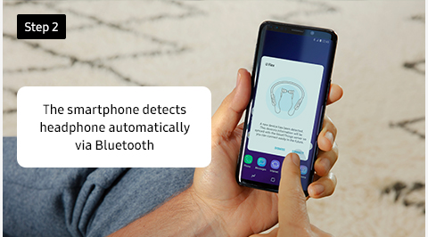 The smartphone detects headphone automatically via Bluetooth