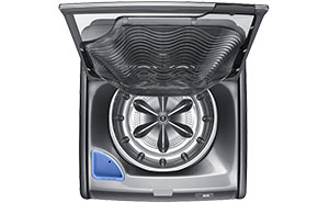 Top load washer - viewed from the above, lid open, built-in sink raised